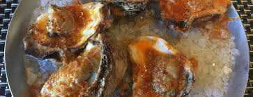 Barbecued Oysters with Red Chili Sauce Image